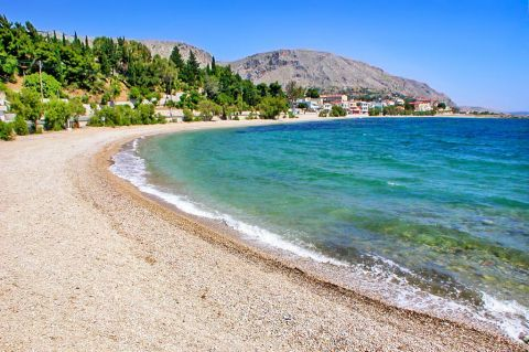 Vrondados: A tranquil beach with clean, blue waters.