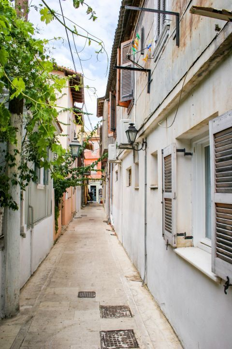 Town: Tall buildings, built close to each other, forming narrow paths.