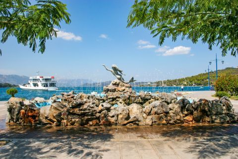 Town: The Mermaid Statue and Fountain on Poros island.