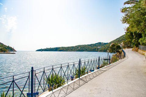 Kioni: A pathway by the sea in Kioni village.