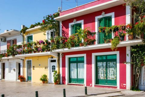 Town: Colorful houses with lovely flowers on their balconies.