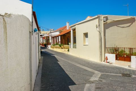 Theologos: A narrow path with traditional houses.
