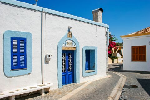 Theologos: A whitewashed chapel with blue colored details in Theologos village.