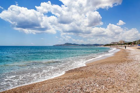 Kallithea: Soft sand with some pebbles and azure waters.