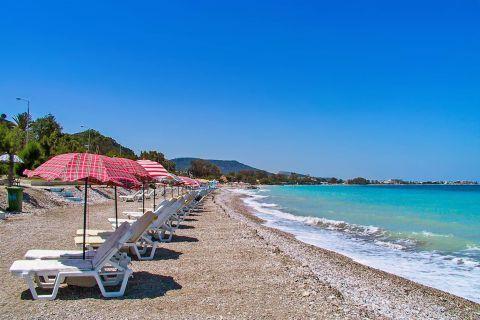 Ixia: Some umbrellas and sun loungers on Ixia beach.
