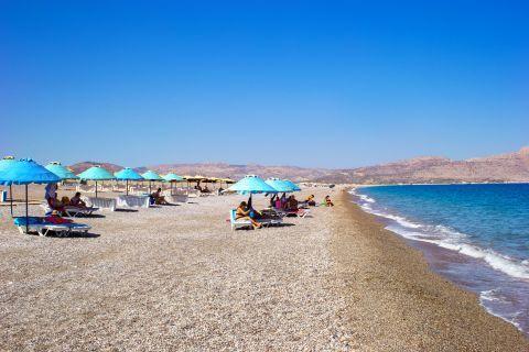 Kalathos: Relaxing moments on Kalathos beach.