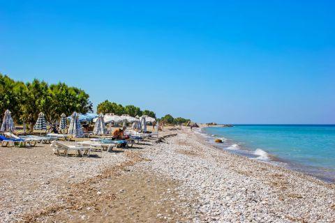 Kremasti: Soft pebbles and sand. Kremasti beach.