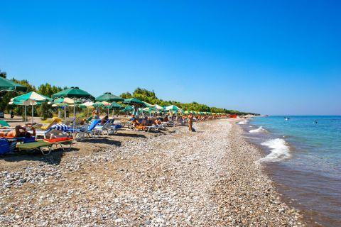 Kremasti: An organized spot with umbrellas and sun loungers. Kremasti beach.