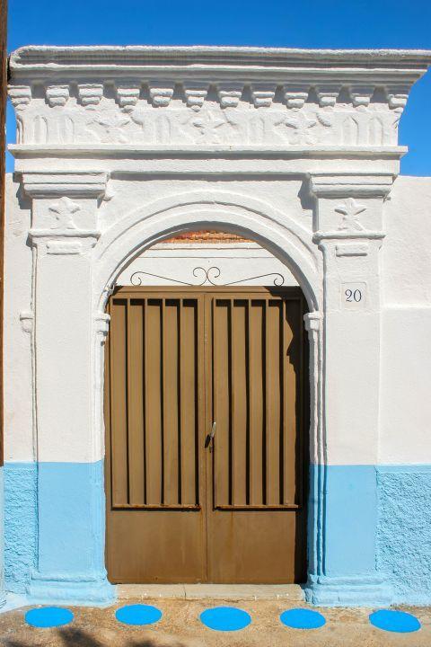 Koskinou: White and blue walls.