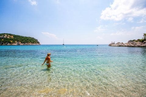 Swim in the crystal clear waters of Stafilos beach.