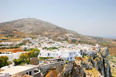 Chora: Nice view of Folegandros. Hills and Cycladic houses, painted in white and blue colors.