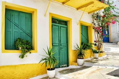 Ioulida: A colorful house, decorated with beautiful flowers.