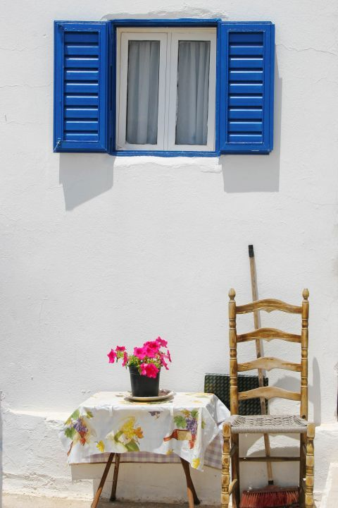 Chora: A white house with blue windows
