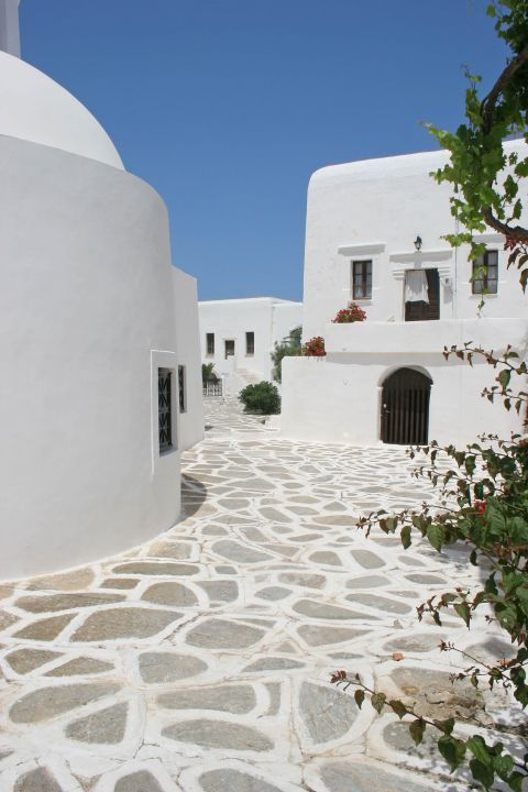Chora: A paved alley with white houses