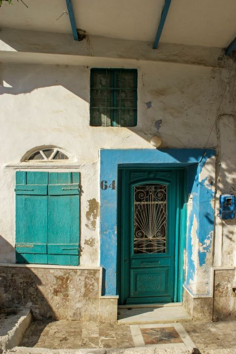 Pyrgi: An old house with a colorful door and shutters.