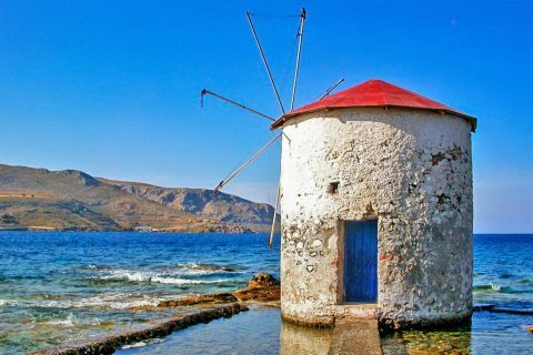 Agia Marina: A vintage windmill by the sea.