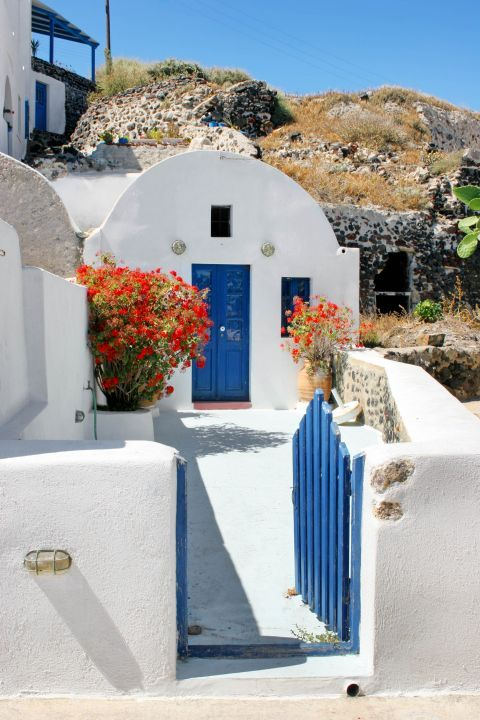 A house painted in white and blue colors