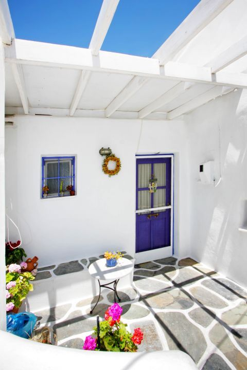 Prodromos: A whitewashed house with a blue-colored door and a blue window