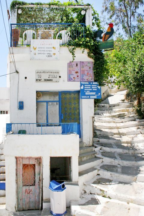 Melanes: A white building with blue-colored details