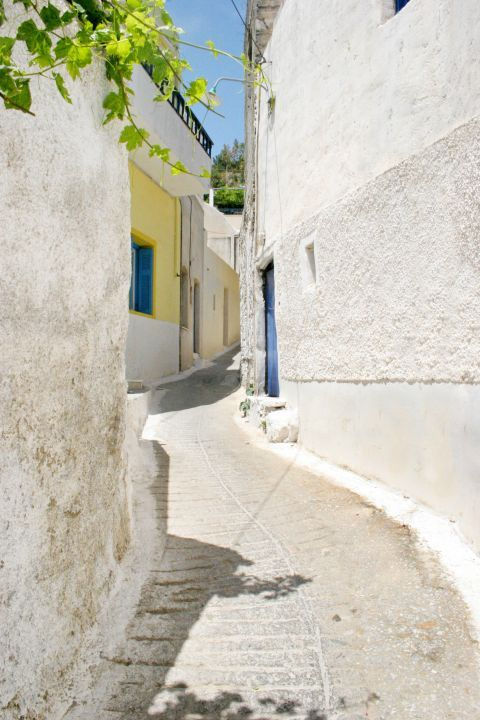 Melanes: An alley with whitewashed buildings