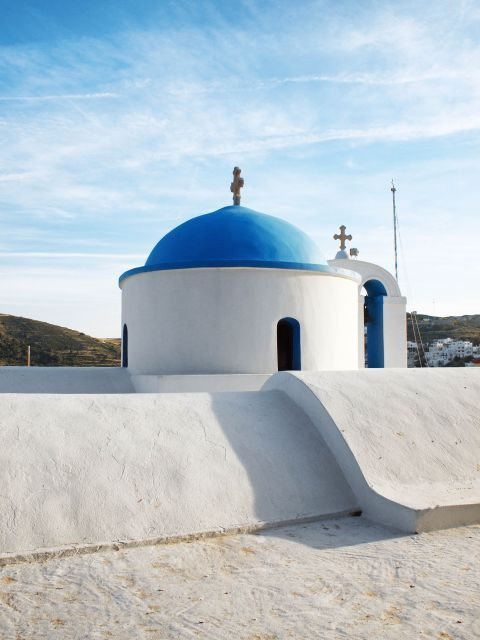 A whitewashed chapel with a blue dome