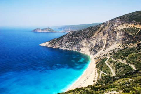Myrtos: Amazing blue waters and cliffs with short vegetation