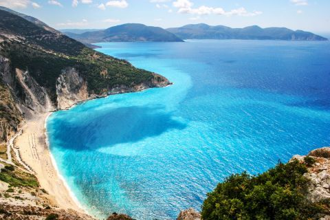 Myrtos: Myrtos beach is located in a beautiful area with huge verdant hills