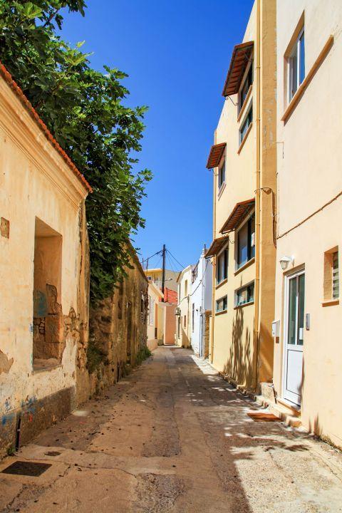 Ialissos Village: A narrow street with impressive buildings.