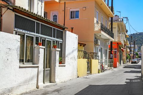 Ialissos Village: A local street with shops and houses.