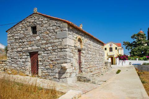 Monolithos: A stone built house and the  Church of Apostle Thomas.