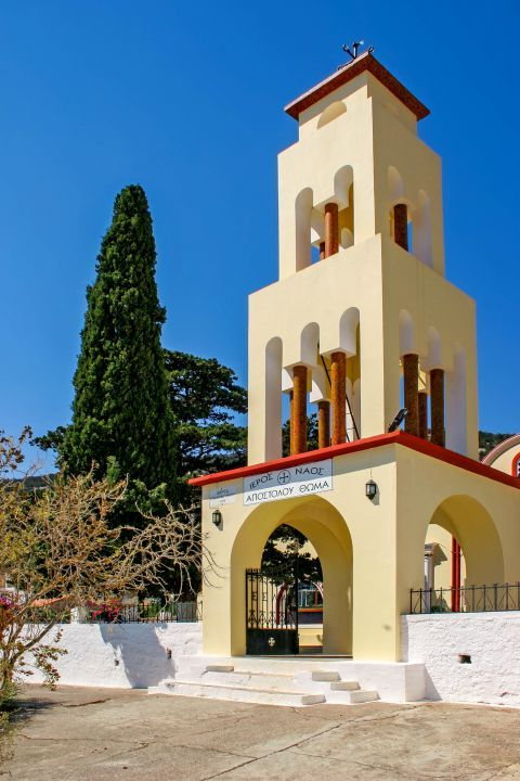 Monolithos: The entrance and the impressive belfry of the  Church of Apostle Thomas.