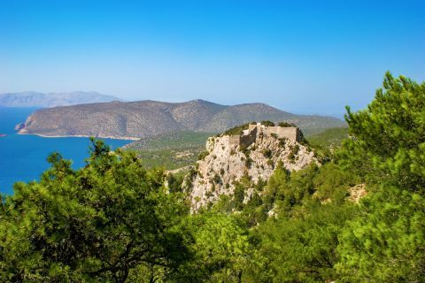 Monolithos: The beautiful 15th century Venetian castle of Monolithos, built by the Knights on top of a rock.