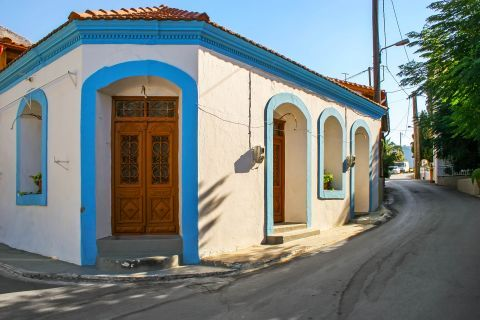 Embonas: White and blue colors, perfectly combined with a wooden door.