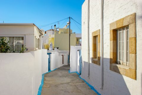 Archangelos: A narrow path with traditional houses.