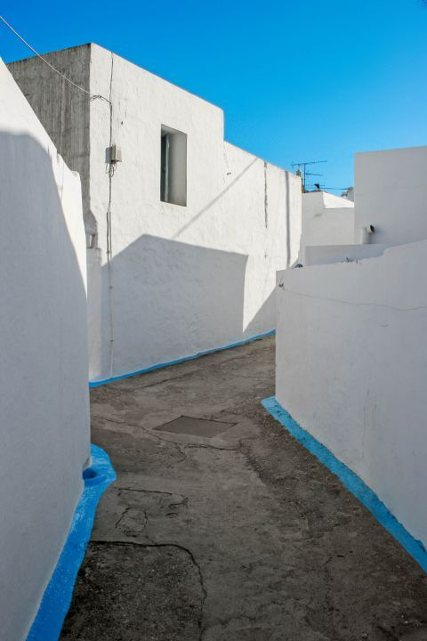 Archangelos: Narrow paths with small, white and blue colored houses.