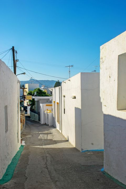 Archangelos: Narrow street with whitewashed houses.