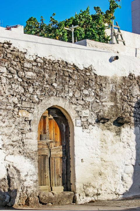 Archangelos: An old, stone built house.