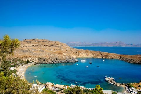 Lindos Beach Megali Paralia: Sparse vegetation and high hills, perfectly combined with blue waters.