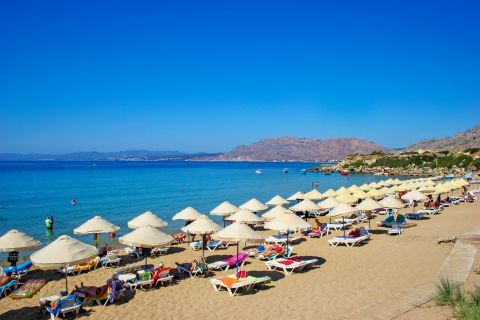 Pefki: Umbrellas and sun loungers on Pefki beach.