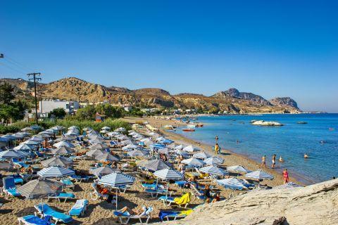 Stegna: Umbrellas and sun loungers on Stegna beach.