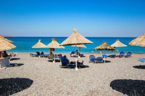 Vlicha: Umbrellas and sun loungers on Vlicha beach.