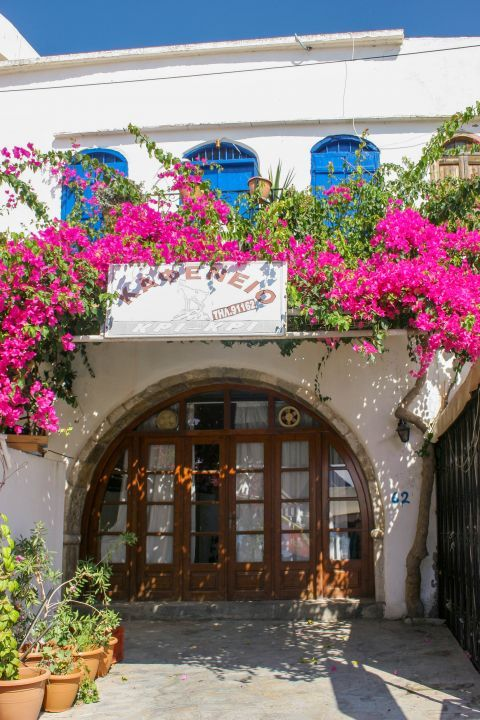 Sfakia: A traditional kafenio, decorated with lovely, fuchsia flowers.