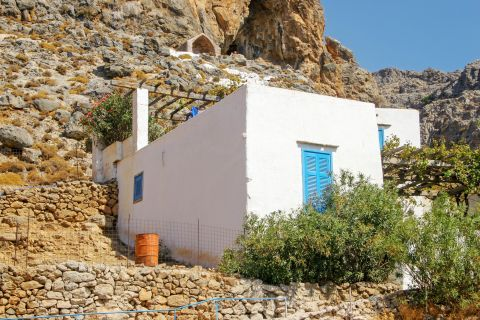 Sfakia: A whitewashed house with blue-colored windows
