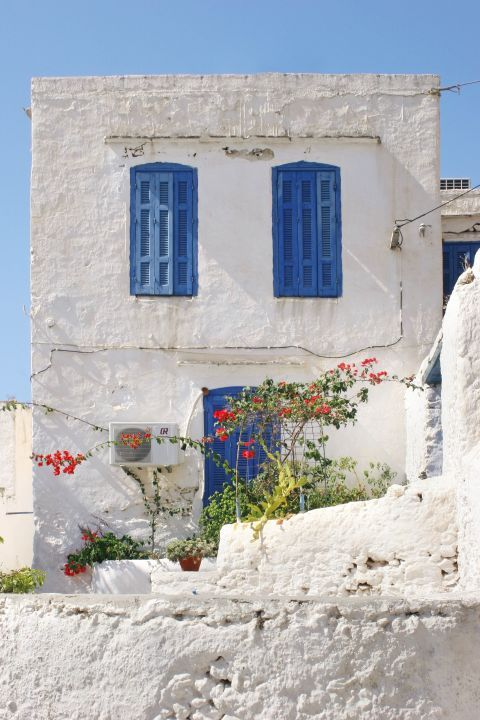 Sfakia: A beautiful house in white and blue colors