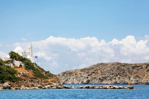 Ormos: A whitewashed chapel, overlooking the sea