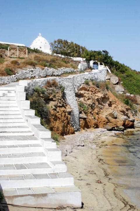 Ormos: Whitewashed stairs, leading to a small chapel
